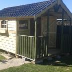 07 10x8 Tongue and Groove Verandah Shed with two tone colour and metal roof